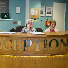 Image of female volunteers on reception